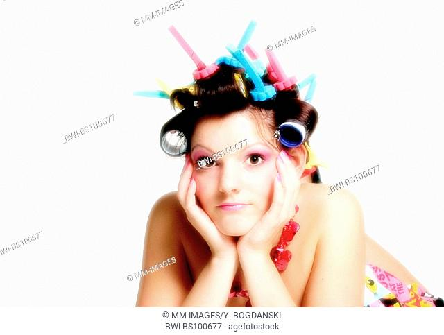 young woman wearing curlers, Germany