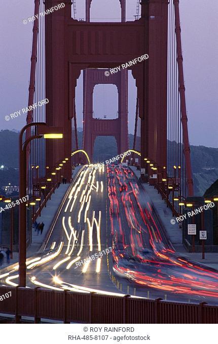 Traffic on the Golden Gate bridge at dusk, San Francisco, California, United States of America U.S.A., North America