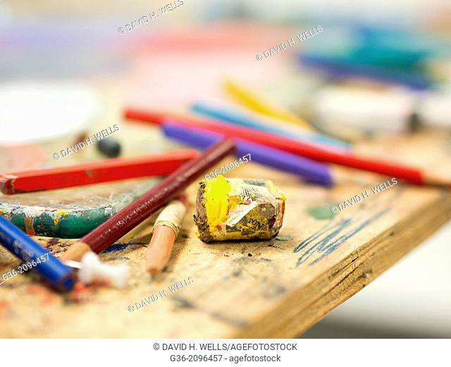 Crayon pencils on messy desk, Atascadero, California, United States