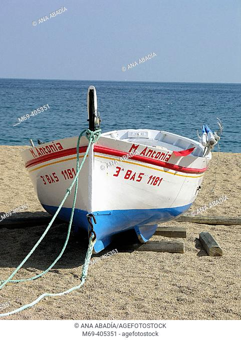 Boat on beach, Tossa de Mar. Costa Brava, Girona province, Catalonia, Spain