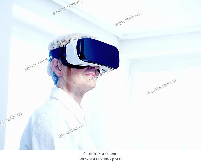 Senior woman wearing Virtual Reality Glasses