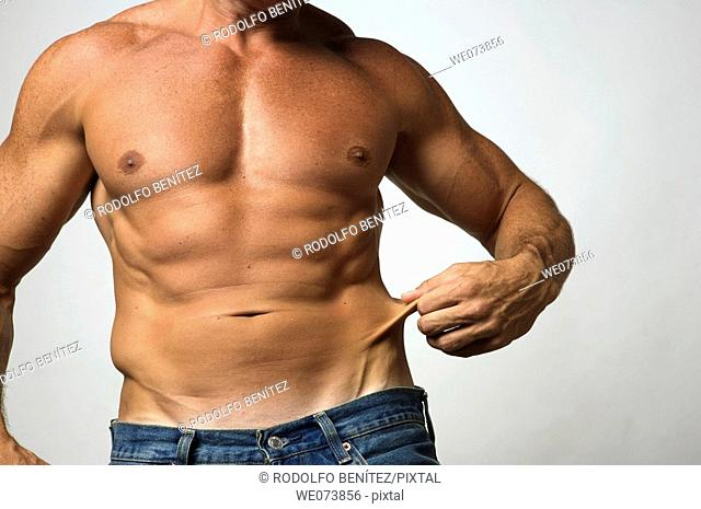 Tough strong man in his 30s showing excess skin