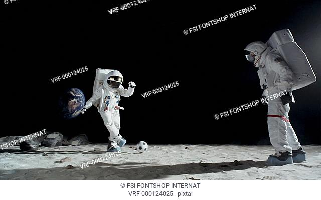 SLO MO, WS, Lockdown of two astronauts on the moon playing soccer