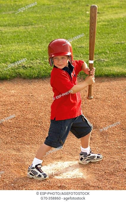 Boy playing baseball ready to swing bat