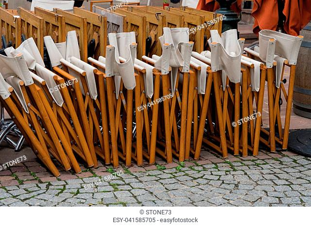 closed chairs lined up in a restaurant in Strasbourg