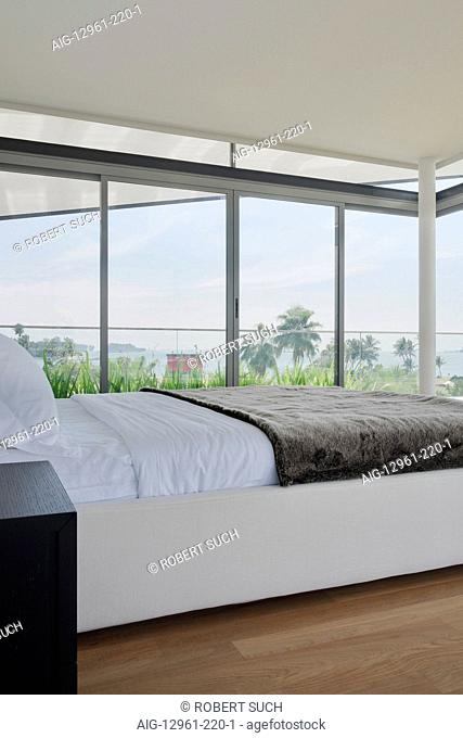 Modern bedroom with views from picture windows