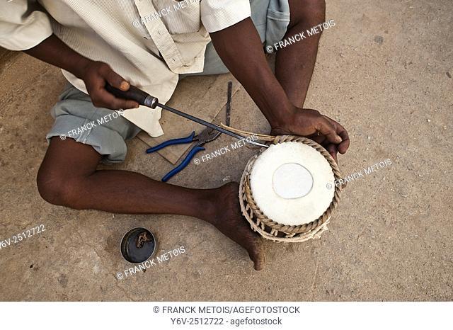 "A man is making a """"tabla"""" ( drum) at Bangalore ( Karnataka, India)"