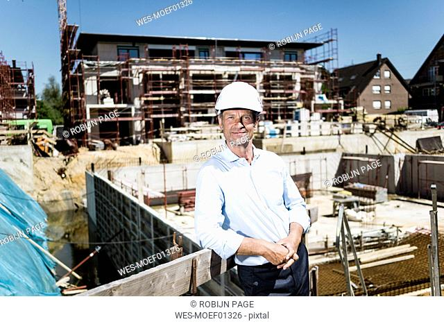 Portrait of confident man wearing hard hat on construction site