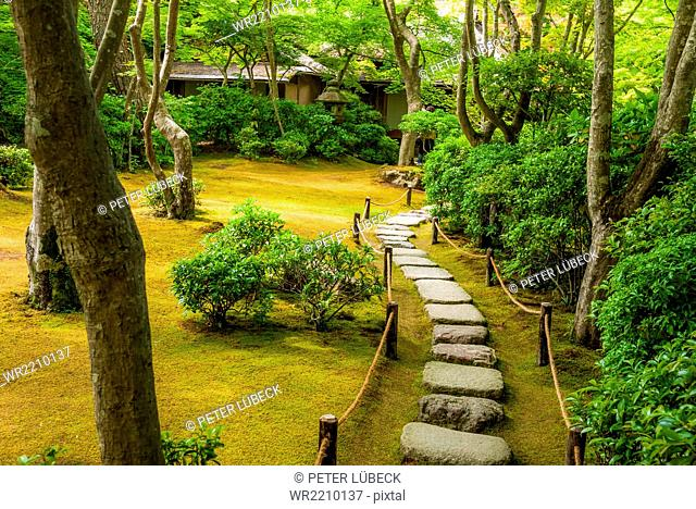 Stone path in Okochi Sanso, the former home and garden of the Japanpanese jidaigeki or period film actor Denjiro Okochi, located in Arashiyama, Kyoto, Japan