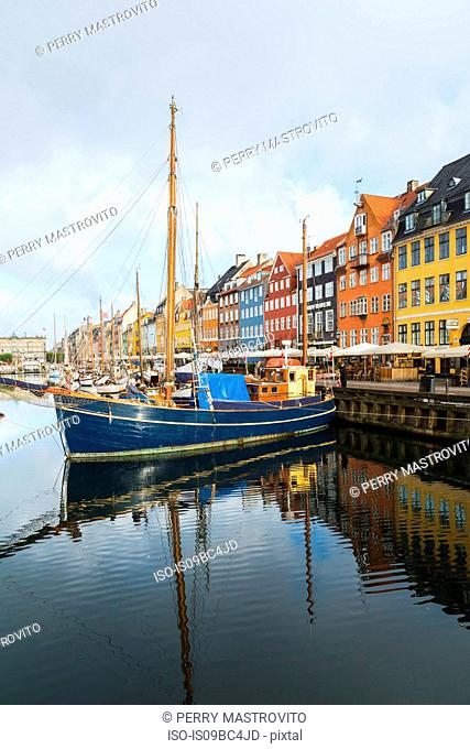 Moored sailboats and colourful 17th century town houses on Nyhavn canal, Copenhagen, Denmark