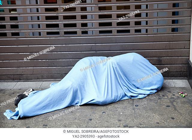 Man Sleeping Rough With Easter Eggs on Sidewalk - London UK