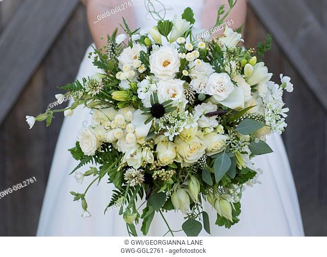 GREEN AND WHITE THEMED BRIDAL BOUQUET WITH ROSES SCABIOSA CARNATION FERN CLOVER AND WILDFLOWERS