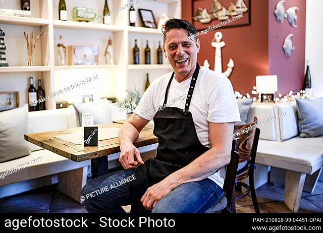 """28 August 2021, Hamburg: Thomas Mau, owner of the restaurant """"""""Leibgericht"""""""", sits at a table in his establishment. Starting next week"""