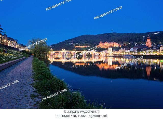 City view with Alte Bruecke bridge Karl-Theodor-Bruecke bridge, Brueckentor gate and castle at night, Heidelberg city, Neckar, Palatinate, Baden-Württemberg