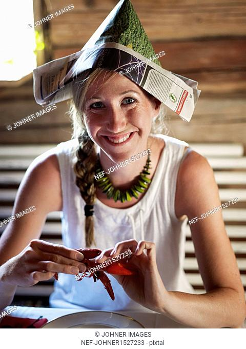 Smiling woman having crayfish