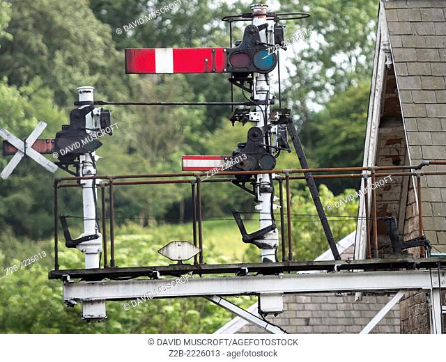 Railway signals at Grosmont station on the North Yorkshire Moors Railway, near Whitby, North Yorkshire, UK