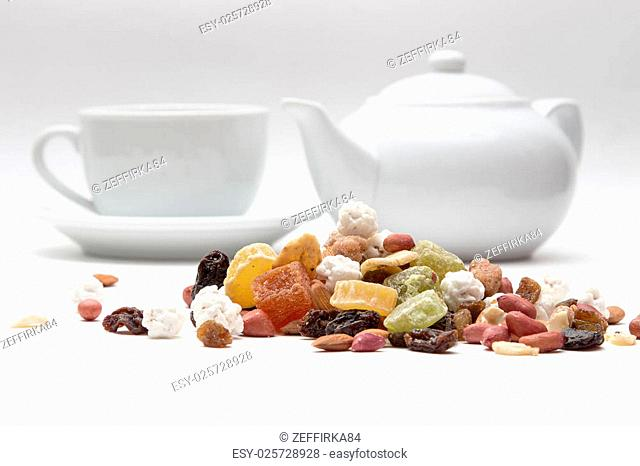 mixed nuts and dried fruit in the background, the kettle and cups
