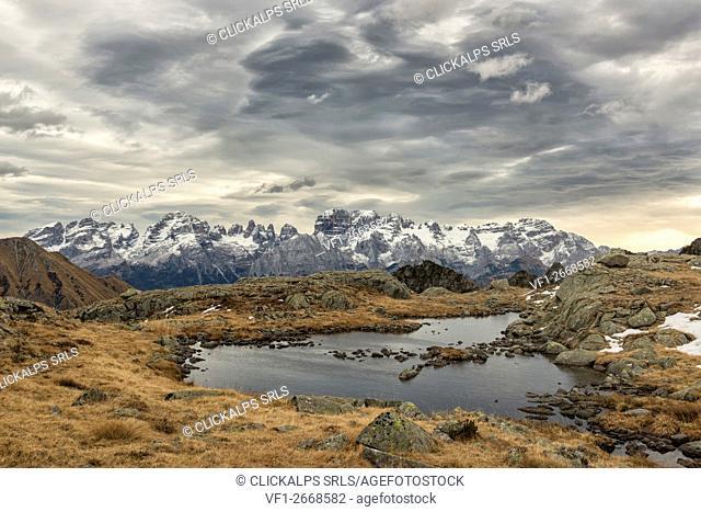 Italy, Trentino Alto Adige, Adamello Brenta Park, Nambrone valley, Black lake with Brenta dolomites in backgroud in a cloud day