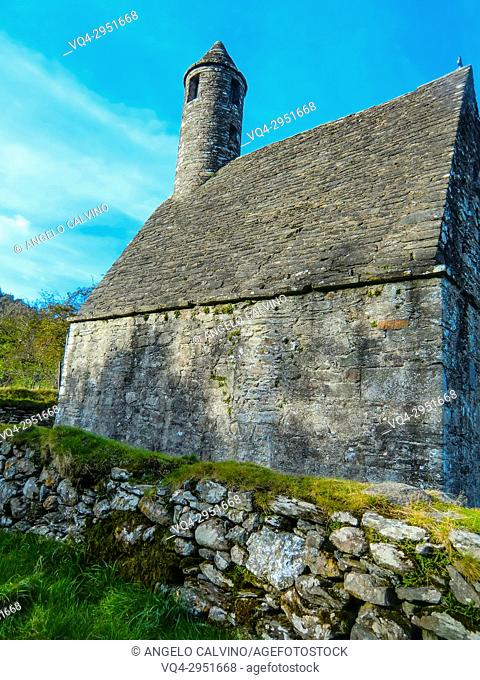 Round Tower and Graveyard in Glendalough Early Monastic Site, County Wicklow, Ireland, Europe