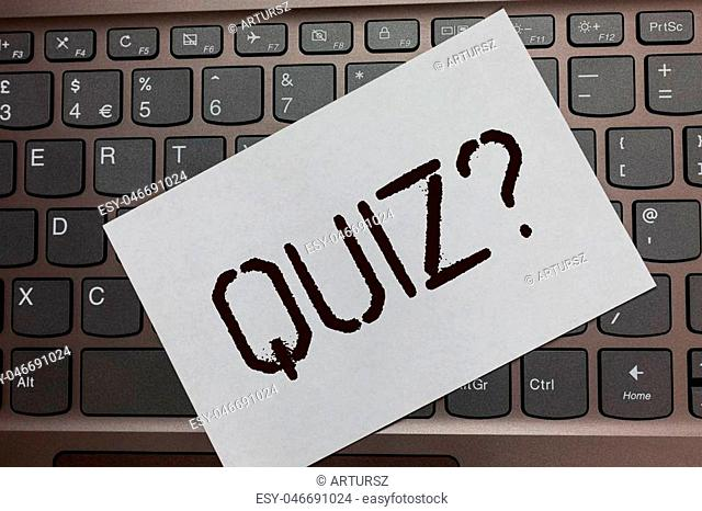 Text sign showing Quiz Question. Conceptual photo Short Tests Evaluation Examination to quantify your knowledge Black laptop keyboard art paper nice computer...