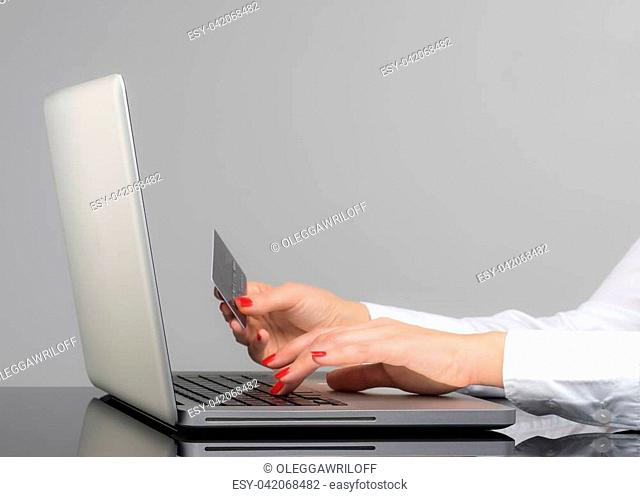 Online payment, Woman's hands holding a credit card and using smart phone for online shopping