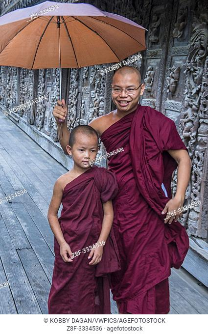 Monks at Shwenandaw Monastery in Mandalay, Myanmar