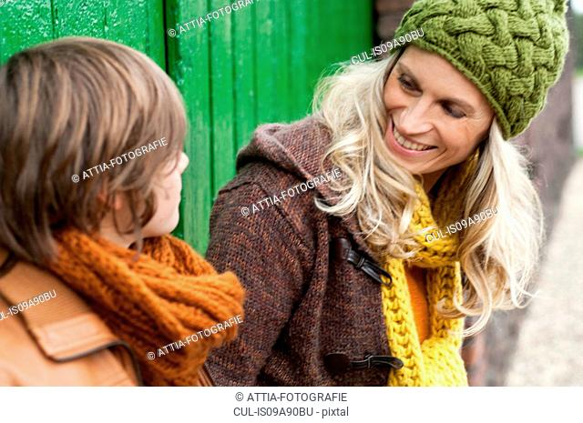 Mother and son smiling together, outdoors