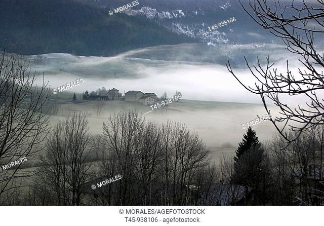 Les Abissaux hamlet in fog at sunrise in winter, Vercors, Drôme, France