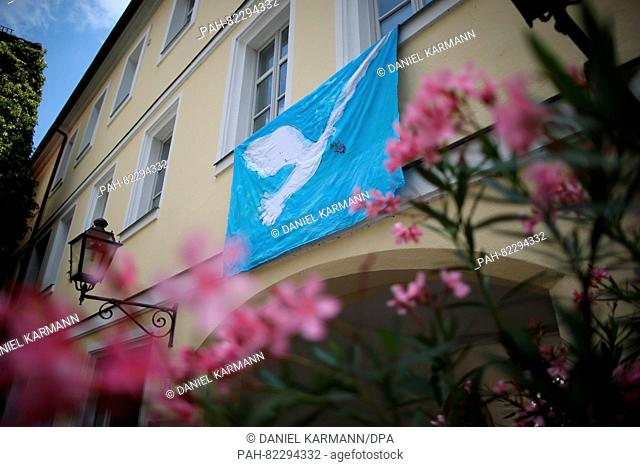 Abanner with a peace dove hangs at the site of the attack past in Ansbach, Germany, 26 July 2016. 15 people were injured in a suspected Islamist-motivated...