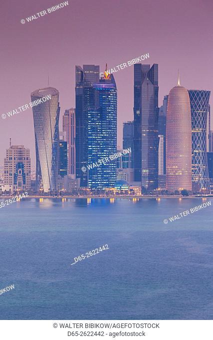 Qatar, Doha, Doha Bay, West Bay skyscrapers, elevated view, dawn