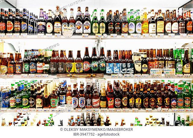 Imported beers on shelves in a Japanese beer store, Tokyo, Honshu, Japan