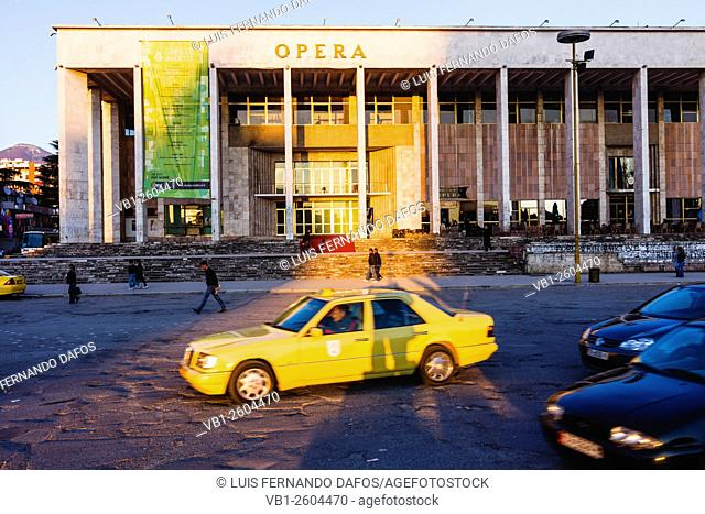 Tirana. Yellow cab and National Theatre of Opera and Ballet of Albania