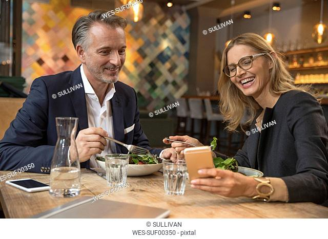 Two business people having lunch in restaurant