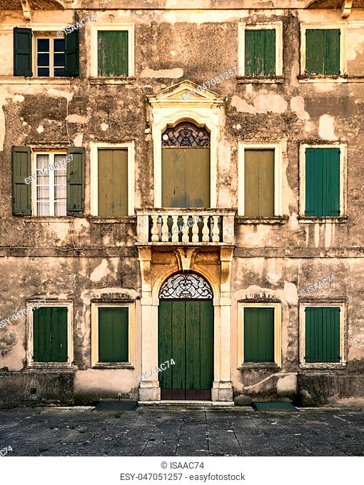 Detail of the facade of an ancient abandoned Italian villa