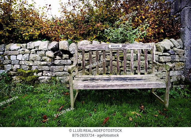 """Wooden bench with """"Private"""" sign. Litton, Yorkshire Dales, North Yorkshire, Skipton, UK"""
