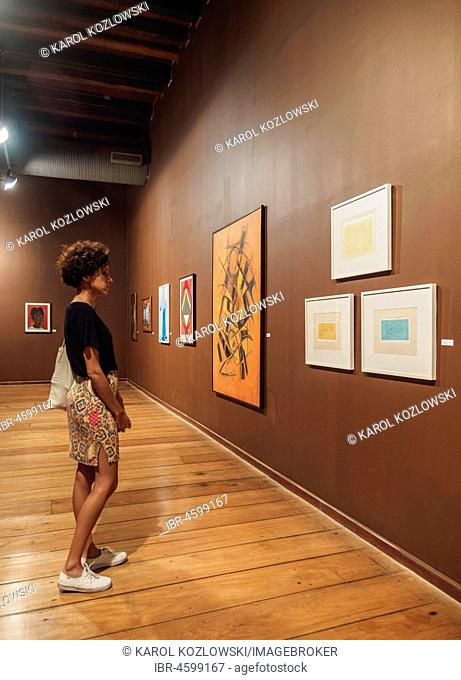 Woman looking at paintings, Solar do Unhao, Museum of Modern Art, interior, Salvador, State of Bahia, Brazil