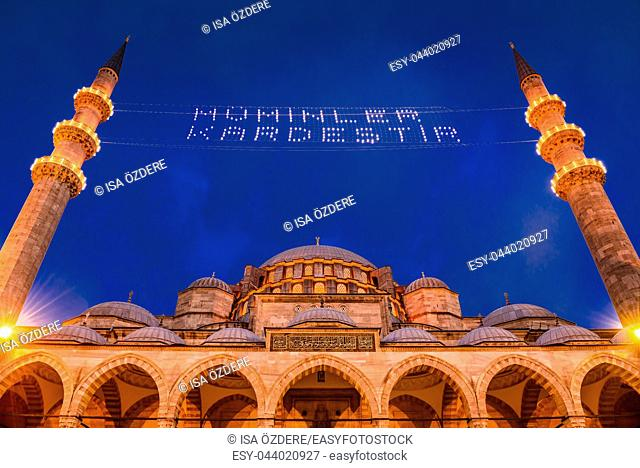 ISTANBUL, TURKEY - JUNE 4, 2017:Mahya of â. . Muslims are brotherâ. . is written and hung between minarets of Suleymaniye Mosque