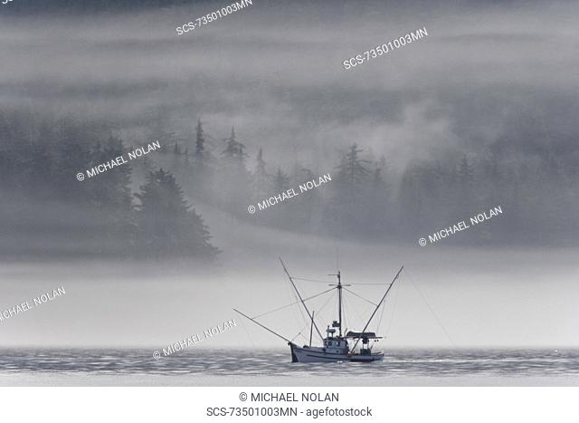 Low-lying clouds and fog create dramatic light on a fishing boat on the northern part of Kupreanof Island in Frederick Sound, Southeast Alaska