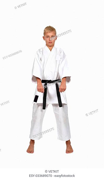 young karate boy isolated on white background
