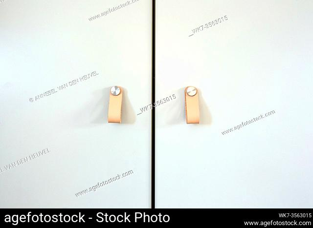 Cupboard Leather door handles Thor modern style, retro decoration for closet doors background texture, close-up design