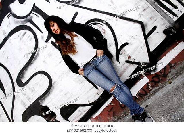 Girl leaning on a Wall