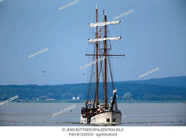 The Dutch flat bottomed boat 'Weisse Duene' ('White Dune') during a guest trip in front of Usedom island near the harbour of Wolgast, Germany, 16 June 2016