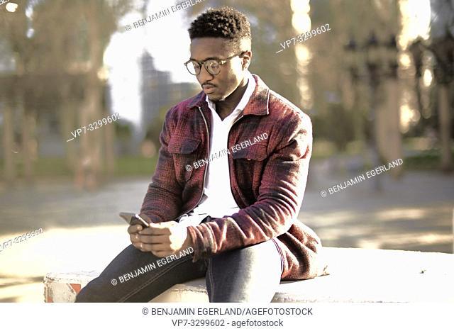 African man using smartphone, in Frankfurt, Germany