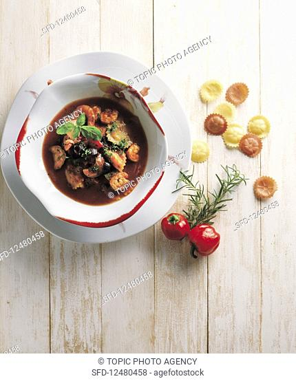 Seafood stew with shrimps, peppers and pasta