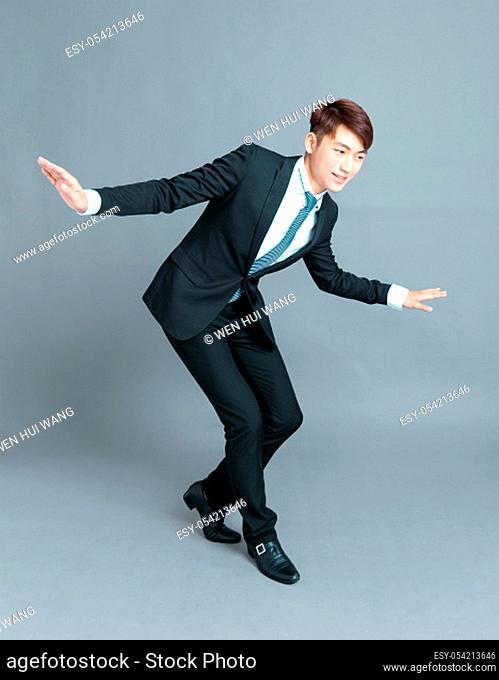 Business man walking carefully, try to balance