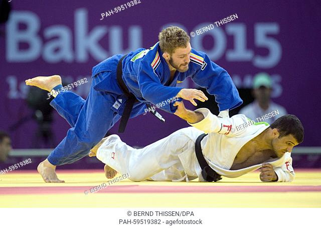 Germanys Tobias Englmaier (blue) competes with Amiran Papinaschwili of Georgia in the Men's -60kg Judo Repechage at the Baku 2015 European Games in Heydar...