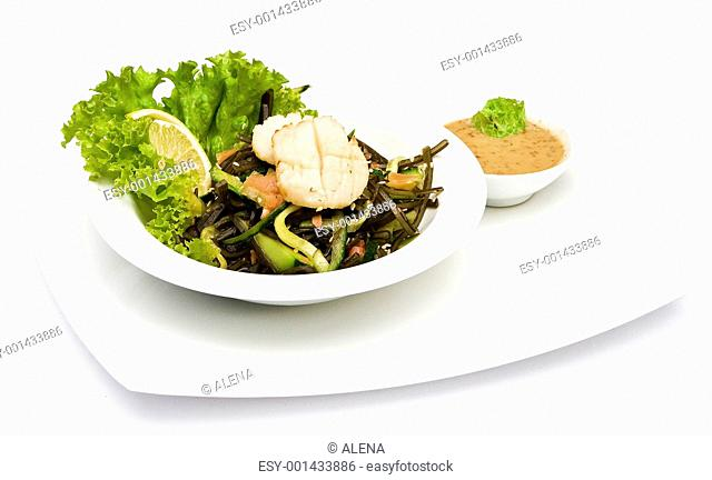 lettuce and shrimps on a white background