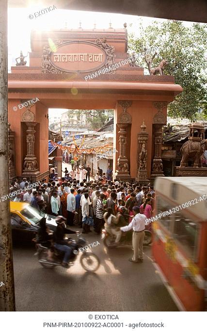 Crowd at the entrance of a temple during religious procession of Ganpati visarjan ceremony, Mumbai, Maharashtra, India