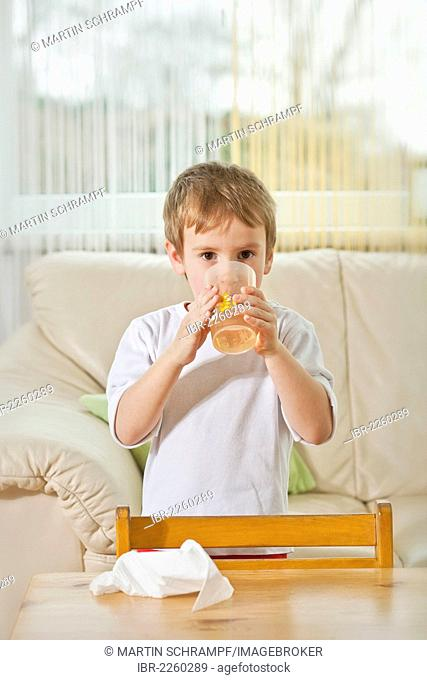 Boy drinking in the living room