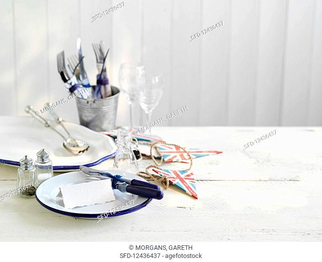 Table laid with salt and pepper shakers and cutlery in champagne bucket